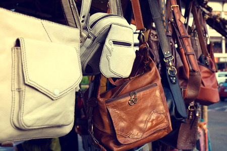 white goods: Vintage leather bags fashion in market Stock Photo