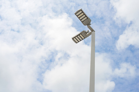 LED street lamps with energy-saving technology, cloud on sky