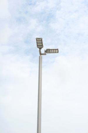 electric avenue: LED street lamps with energy-saving technology, cloud on sky background