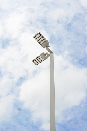 electric avenue: LED street lamps with energy-saving technology, cloud on sky