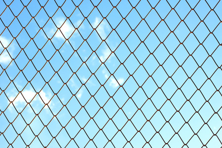 mesh fence with blue sky background photo
