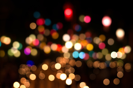 disco lights: Lights blurred bokeh background from christmas night party for your design, vintage or retro color tone Stock Photo