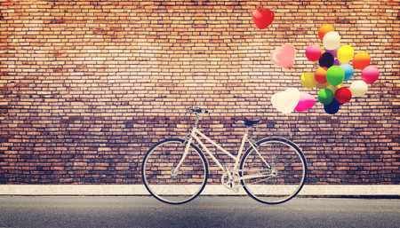 Card of bicycle vintage with heart balloon on road urban city concept of love in summer and wedding honeymoon 版權商用圖片