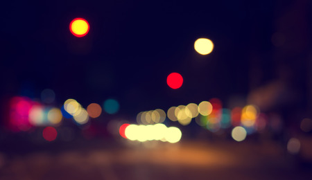 out of focus: Artistic style - Defocused urban abstract texture ,bokeh of city lights in the background with blurring lights for your design, vintage or retro color tone Stock Photo