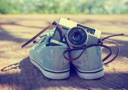 photographic camera: Vintage camera isolate with Sneakers