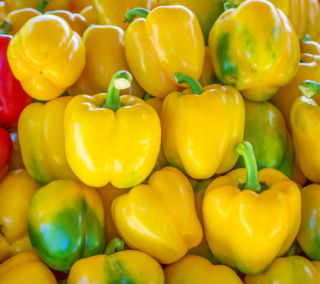 group of yellow bell pepper in market photo