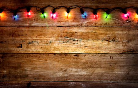 Christmas rustic background - vintage planked wood with colorful lights and free text space