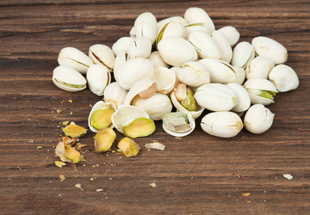 pistachios: pistachio on wood background