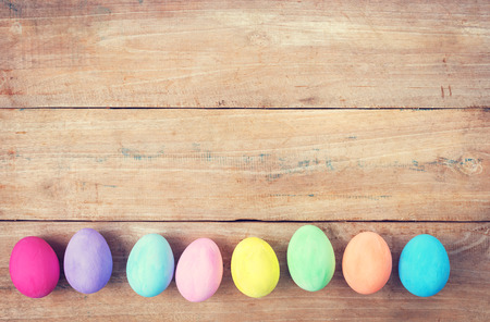 Vintage colorful easter eggs on wood table background photo