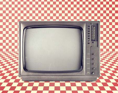 Vintage television isolate on Red checkerboard pattern ,retro technology