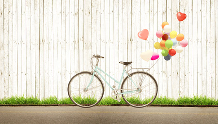 bicycle vintage with heart balloon concept of love in summer and wedding honeymoon, white wood background