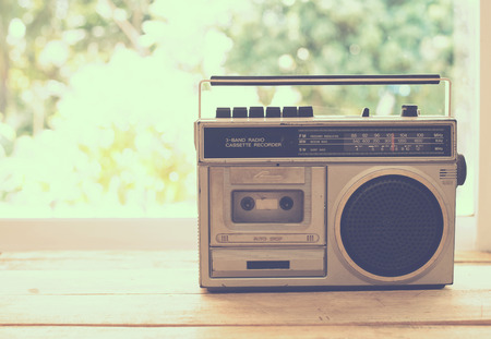 radio communication: vintage radio on table nature background