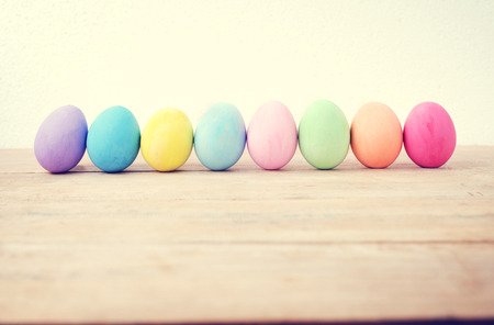Vintage colorful easter eggs on wood table empty background Stock fotó