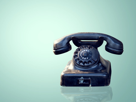phone number: Vintage telephone on blue wallpaper