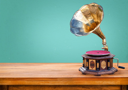 Old gramophone ,retro radio receiver vintage green background