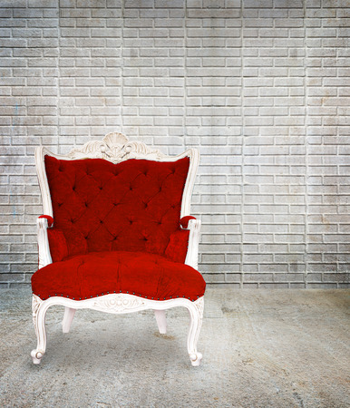 red chair: Red armchair classical style in grunge vintage room, interior design Stock Photo