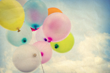 birth day: vintage colorful balloon on blue sky concept of happy birth day, paper aet texture Stock Photo