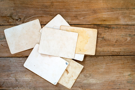 texture paper: Vintage photo paper on wood background Stock Photo