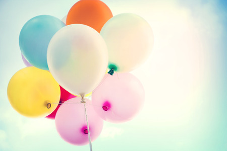 balloon: vintage colorful balloon on blue sky concept of love in summer and valentine, wedding honeymoon
