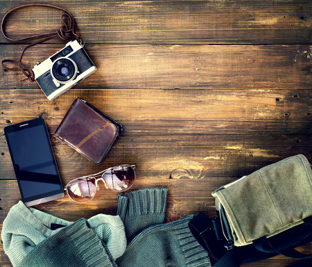 casual men: top view of hipster accessory on old wooden  background