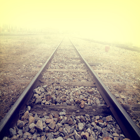 Landscape of railroad tracks at train station - retro, vintage filter effect style. Stock Photo
