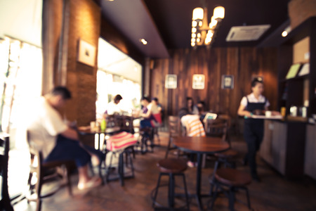 shop interior: Coffee shop - cafe blurred background with bokeh image