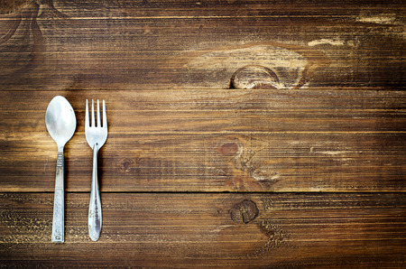 vintage cutlery: Vintage silverware on old wood table