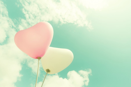 heart in love: vintage heart balloon on blue sky concept of love in summer and valentine, wedding honeymoon
