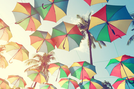 party background: Vintage colorful umbrella on side beach - festival party in summer