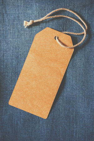 Empty brown paper tag of jean.  Stock Photo