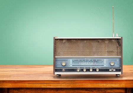 retro radio: Old retro radio on table with vintage green eye light background