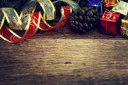 green frame: Christmas pine tree with decoration on wooden board background with copy space (Vintage filter effect) Stock Photo