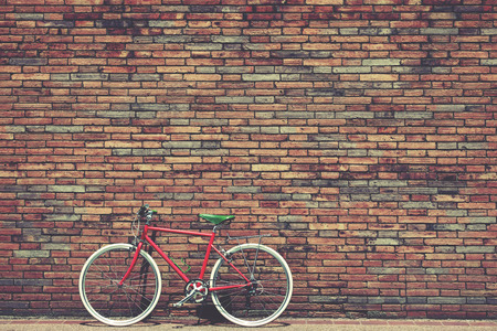 bikes: Retro bicycle on roadside with vintage brick wall background