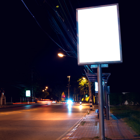street signs: blank of billboards at  side road in night