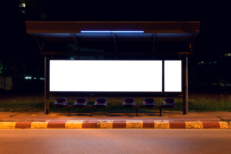 side of the road: blank of billboards at bus stop side road in night Stock Photo