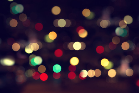 bokeh background: Lights blurred bokeh background from christmas night party for your design, vintage or retro color effect