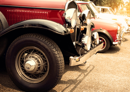 Detail of front vintage car wheels and headlight - Classic vehicles