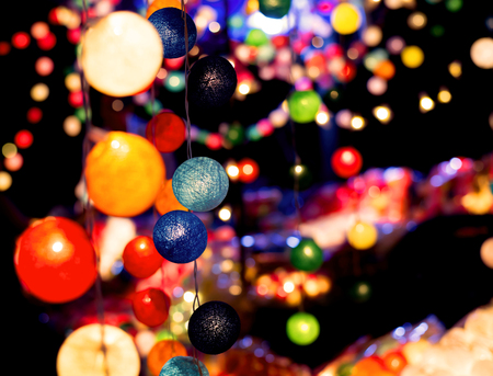 Multicolor light ball with blurred background at festiva party night