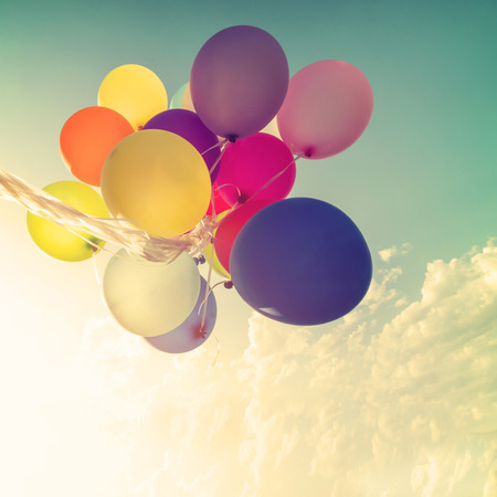 multicolored balloons with a retro vintage   filter effect, concept of happy birthday in summer and wedding honeymoon party (Vintage color tone) Reklamní fotografie