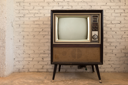 Retro old television in vintage white wall background Stock Photo