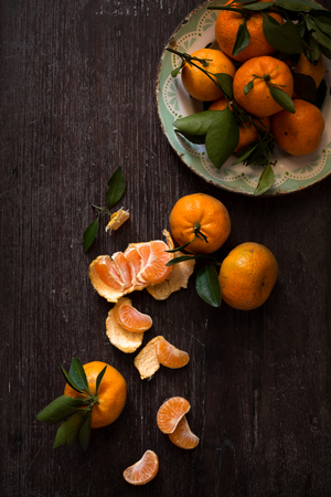 food photography: Dark moody food image of fresh ripe orange on wooden table - still life photography. vintage style