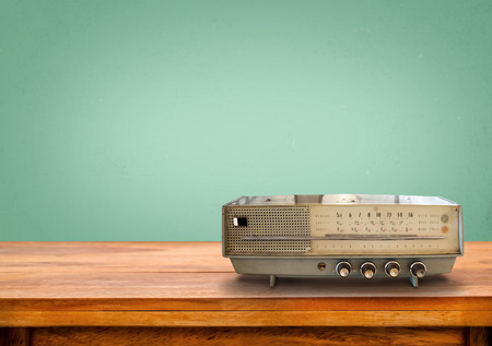blue green background: Old retro radio on table with vintage green pastel background Stock Photo