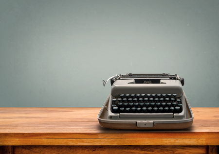 old letters: Old retro Typewriter on table with vintage gray gradient background