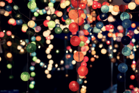Vintage blurred background of multicolor light ball at festiva party night