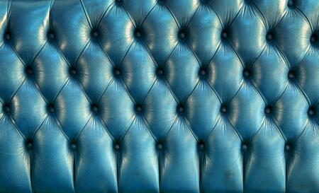 blue leather sofa: Blue leather texture of vintage sofa - retro background Stock Photo