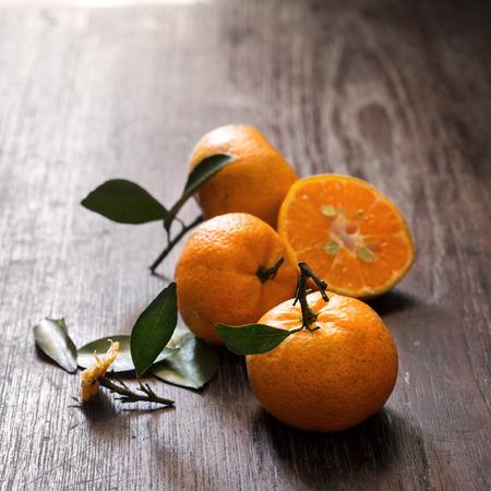 food photography: Three citrus - fresh ripe orange on wooden table. dark moody food photography Stock Photo