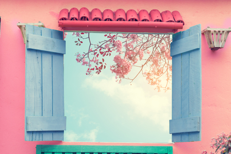 Sweet cute open window with sakura pink flower viewpoint. vintage pastel color effect Stock Photo