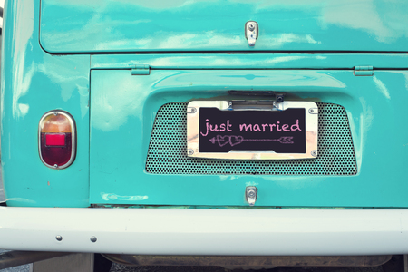just married sign on aquamarine classic vintage van. concept of love - wedding and honeymoon in summer Фото со стока