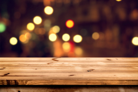 product placement: Empty wooden table for product placement or montage with focus to the table top, blurred bokeh background .