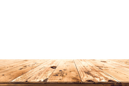Empty wood table top ready for your product display montage. with white background.